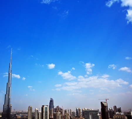 Dubai modern cityscape, downtown with blue sky background, border composition, luxury new high-tech city at Middle East, United Arab Emirates, Burj Khalifa tower