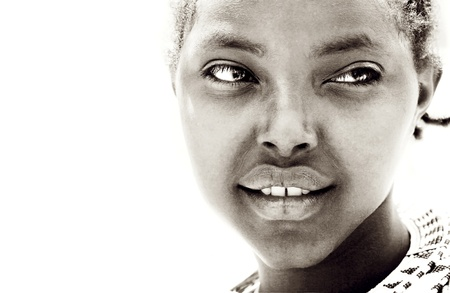 Closeup portrait of an young African girl, isolated