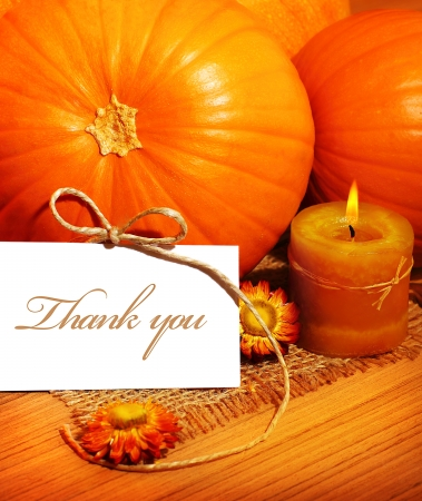 Thank you, thanksgiving greeting card with pumpkin decorations and warm candle light, holiday still life with white copy space photo