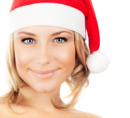 Pretty Santa girl, closeup portrait of a young woman smiling, wearing Christmas hat, winter holidays fun, female face isolated over white background photo