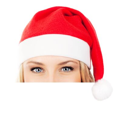 Santa girl closeup portrait, half face of a young woman smiling, wearing Christmas hat, winter holidays fun, isolated over white background with copy space photo