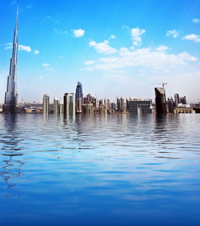 Dubai modern cityscape reflected in water, downtown with blue sky background, luxury new high-tech city at Middle East, United Arab Emirates, Burj Khalifa tower
