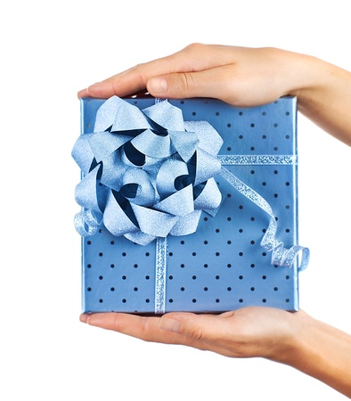 Woman hands holding beautiful blue gift box, giving gift concept, christmas holidays and greeting season, isolated on white background photo