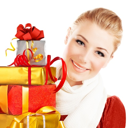 Beautiful woman with presents, close up portrait of female with Christmas gifts, girl giving and getting gift concept, greeting season and winter holidays, isolated on white background photo