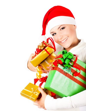 Happy Santa girl holding colorful Christmas gifts, Christmastime fun and joy, celebration of winter holidays, diversity of presents, isolated on white background photo