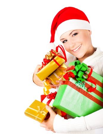 Happy Santa girl holding colorful Christmas gifts, Christmastime fun and joy, celebration of winter holidays, diversity of presents, isolated on white background photo