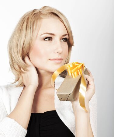 Beautiful woman with present, portrait of female with gift, girl giving and getting gift concept, holidays Stock Photo - 11600161
