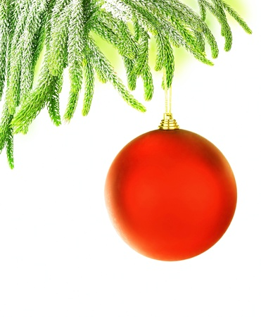 Christmas tree green border with big red hanged bauble, traditional ornament and decoration for winter holidays, isolated on white background photo