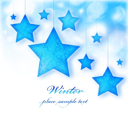 Blue stars, Christmas tree ornaments and holiday decorations, winter border with bokeh lights and white text space photo