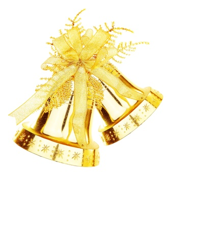 Golden jingle bell, Christmas tree ornament and holiday decoration isolated on white background photo