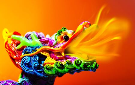 Colorful dragon head with tongue of fire flame, traditional Asian decoration and ornamental art, Chinese Zodiac, astrology sign, 2012 New Year symbol photo