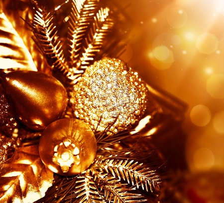 Golden Christmas tree decoration, winter holidays ornament, festive border, gold background with magic glow lights photo