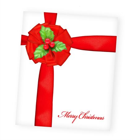 Merry Christmas greeting card wrapped with red ribbon, big silk bow over paper postcard, beautiful Christmastime gift, romantic present photo