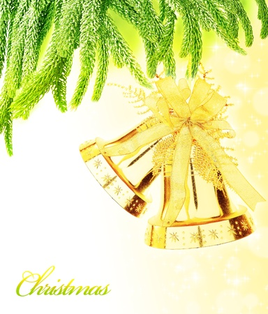 Christmas tree green border with big golden jingle bells toy, hanging bauble, traditional ornament and decoration for winter holidays, isolated on white background, decorating home at Christmastime and New Year photo