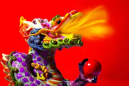Colorful dragon head with tongue of fire flame, traditional Asian decoration and ornamental art, Chinese Zodiac, astrology sign, 2012 New Year symbol Stock Photo - 11790604