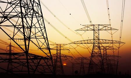 Electricity Pylon over orange sunset sky, environmental damage Stock Photo - 11790608