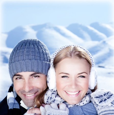 Happy couple hugs, holding hands, close up face portrait, outdoor at winter snowy mountains, people over natural blue wintertime landscape background, Christmas vacation holidays, love concept Stock Photo - 11963076