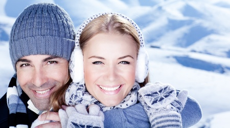 couple winter: Happy couple hugs, holding hands, close up face portrait, outdoor at winter snowy mountains, people over natural blue wintertime landscape background, Christmas vacation holidays, love concept