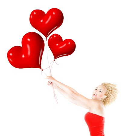 Happy girl flying, female holding red heart balloons, woman having fun and laughing, body isolated on white background, crazy in love concept photo