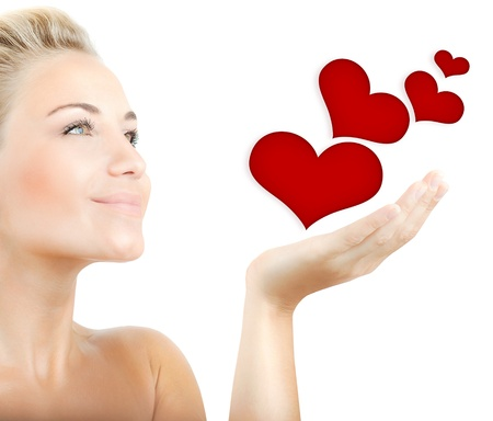 hands holding heart: Beautiful woman holding hearts in hand, sensual female portrait isolated on white background, cute girl expressing tender feelings, conceptual image of health care and love Stock Photo