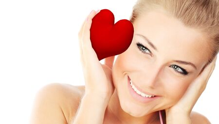 Isolated portrait of a beautiful female with a big red heart in hands, sensual woman on white background, cute girl face expressing positivity, conceptual image of health care and love photo