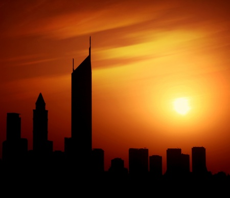 Dubai city at night Sheikh Zayed road at sunset, silhouette of modern new Middle Eastern city, black shape of buildings with natural sun light background, United Arab Emirates photo