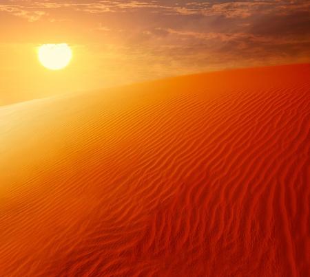 Extreme desert landscape with orange sunset, beautiful sandy background with hot sunlight, wilderness, beauty of nature, United Arab Emirates, Dubai photo