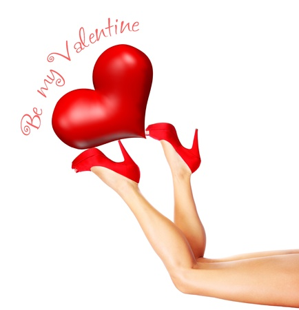 Beautiful sexy female legs holding up the big red heart, wearing stylish high heels isolated on white background with text space, Valentine Stock Photo