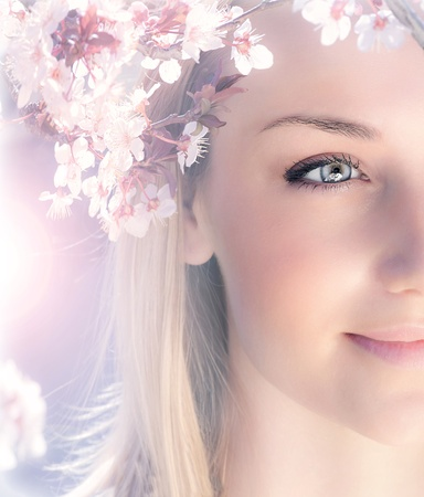 Sensual portrait of a spring woman, beautiful face female enjoying cherry blossom, dreamy girl with pink fresh flowers outdoor, seasonal nature, tree branch and glamorous lady photo