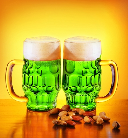 st patrick day: Irish green beer, traditional alcohol for st.Patricks day holiday celebration, lucky clover beverage, two glasses with nuts, food and drink still life
