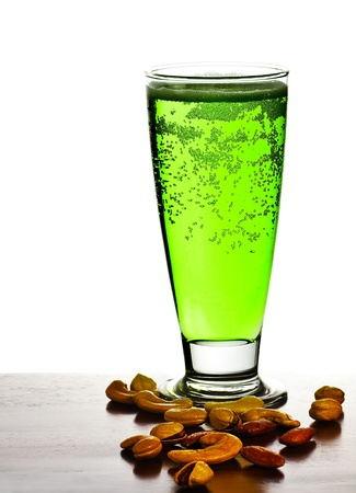 beerglass: Irish green beer, traditional alcohol for st.Patricks day holiday celebration, lucky clover beverage, glass with nuts, food and drink still life, isolated on white background Stock Photo