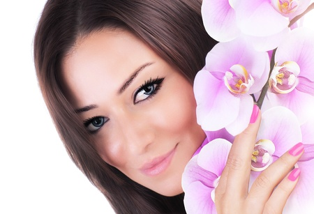 pink orchid: Beautiful female holding pink fresh orchid flower, sensual female portrait isolated on white background, girl with spring plant, spa skin care and beauty concept