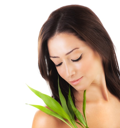 Healthy woman relaxing at spa, sensual female portrait with green fresh leaves, young lady with spring plant, girl isolated on white background, skin care concept Stock Photo - 12589045