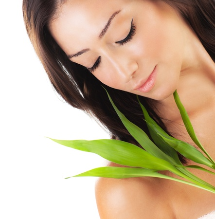 Healthy woman relaxing at spa, sensual female portrait with green fresh leaves, young lady with spring plant, girl isolated on white background, skin care concept Stock Photo - 12589149