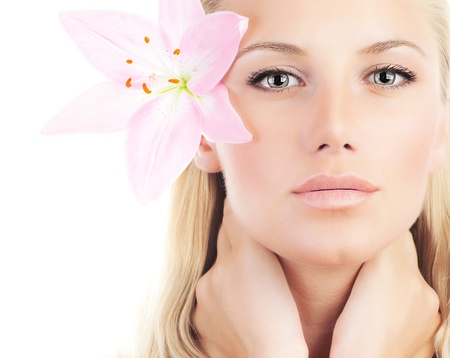 Beautiful woman with pink fresh lily flower, sensual female portrait isolated on white background, girl with spring plant, spa skin care and beauty concept photo