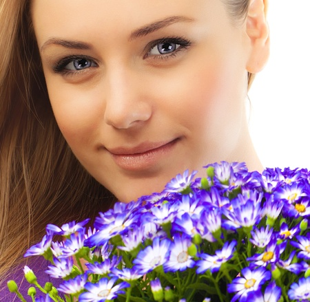 Beautiful female holding flowers, closeup on face, girl with bouquet of spring plant, bunch of purple cornflowers, lovely woman with gift isolated over white background photo