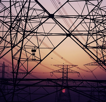 Abstract background of electricity pylons over purple sunset, conceptual image of invironmental damage and pollution of nature Stock Photo - 12879510