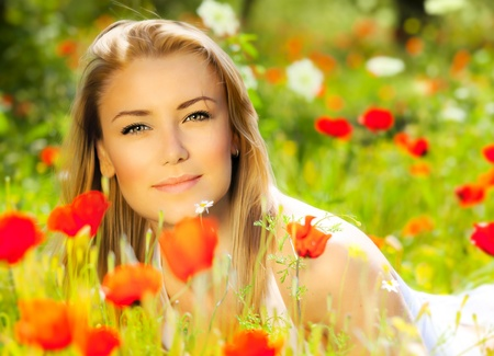 Young beautiful girl enjoying on the poppy flowers field, outdoor portrait, summer fun concept, beautiful woman relaxing in the floral garden, female at fresh spring meadow, people rural leisure Stock Photo - 12880055