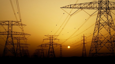 Electricity Pylon over orange sunset sky, environmental damage concept Stock Photo - 12879962