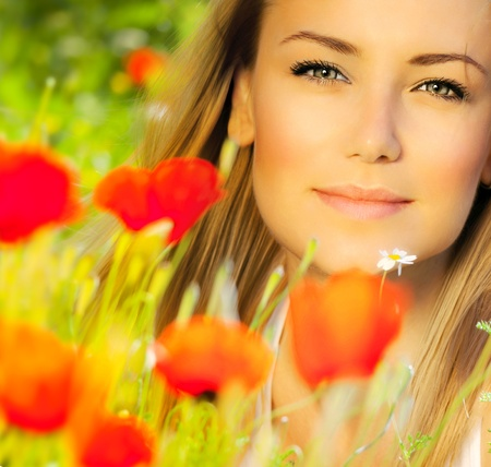 bakground: Closeup on beautiful woman face, female enjoying flower field, lovely girl at spring outdoor vacation, nice model relaxing at floral poppy garden, gorgeous model over natural bakground  Stock Photo