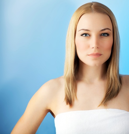 Beautiful face woman over blue background, sensual female portrait, european model girl, healthy young lady, spa and beauty care concept photo