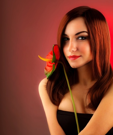 hot sexy girls: Sexy red hair woman holding calla flower, glamour girl isolated over red background, stylish lady, female fashion session at indoor studio, beautiful face closeup portrait Stock Photo
