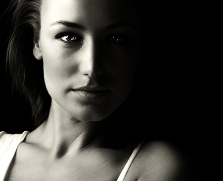 Black and white glamor woman portrait, dark beautiful face, female isolated on black  photo
