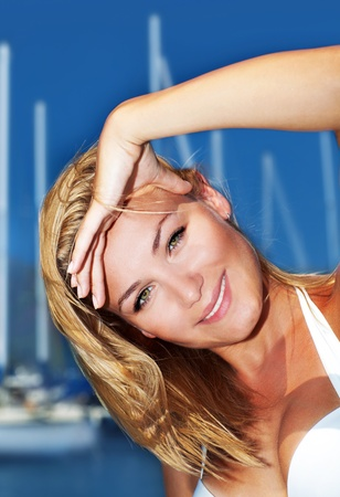 Woman enjoying sailing trip, close-up portrait on happy smiling female face, summer cruise holidays, European girl tourist traveling in sail boat around the world Stock Photo - 13077545