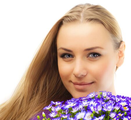 Beautiful female holding flowers, girl with bouquet of spring plant, bunch of purple cornflowers, lovely woman with gift isolated over white background photo