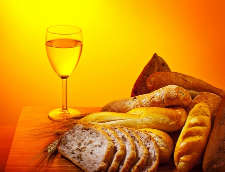 Holy supper, communion dinner, bread and glass of wine, Sunday christian traditional food, celebrating religious holidays  photo