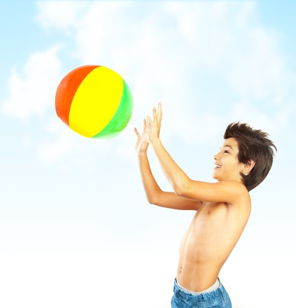 throw up: Happy boy with beach ball over blue sky, kid having fun outdoor, healthy child playing outside, cute teen enjoying sport and nature, summer holidays and vacation