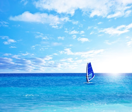 freedom leisure activity: Beautiful peaceful paradise beach, man playing windsurf, scenic blue natural seascape landscape, tropical nature background, summer fun outdoor activities, freedom and travel, active people lifestyle