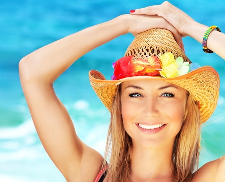 Happy young woman on the beach, beautiful female face outdoor portrait, pretty healthy girl relaxing outside, nature fun and joy, spa and travel concept photo
