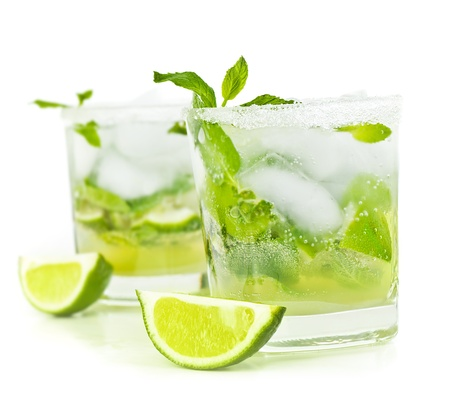 alcoholic drinks: Cold mojito drink, glass of alcohol isolated over white background, fresh mint and lime fruit slice, food still life, party and holidays celebration